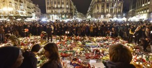 Hundreds of people come together at the Place de la Bourse to mourn on Wednesday evening, March 23, 2016. Bombs exploded yesterday at the Brussels airport and one of the city's metro stations, killing and wounding scores of people, as a European capital was again locked down amid heightened security threats. (ANSA/AP Photo/Martin Meissner)