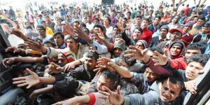 migranti mani tese